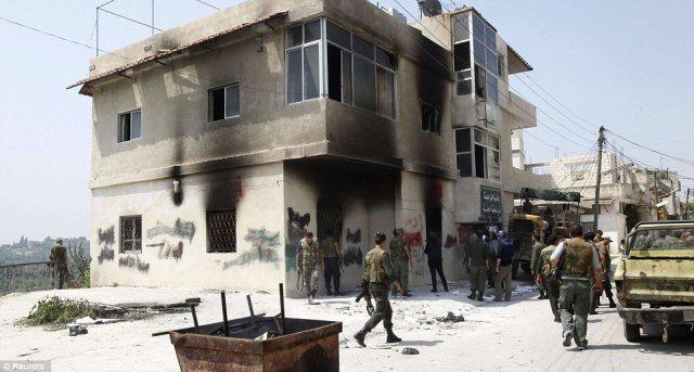 Les forces assadiennes ayant investi le village fantôme d'al Haffah